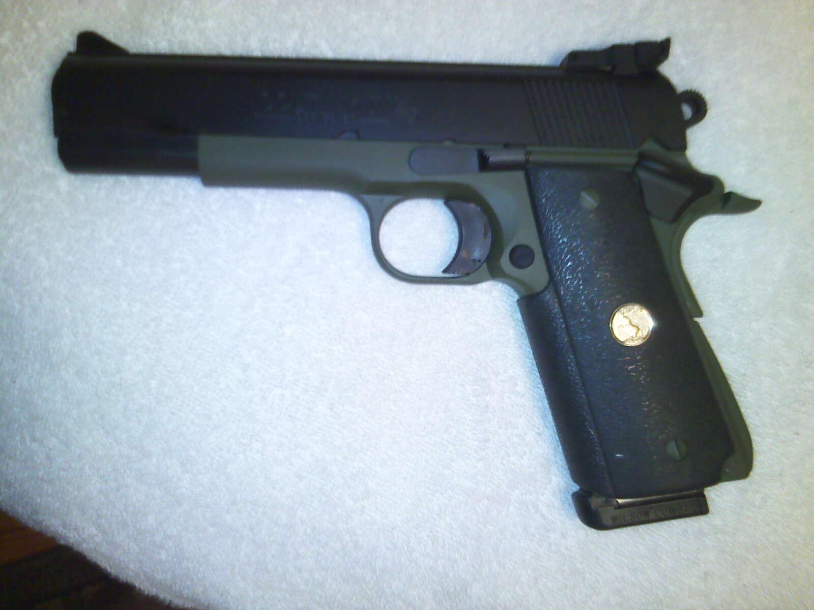 Old Colt 1911 with Cerakote coating-10-12-11_1841-jpg