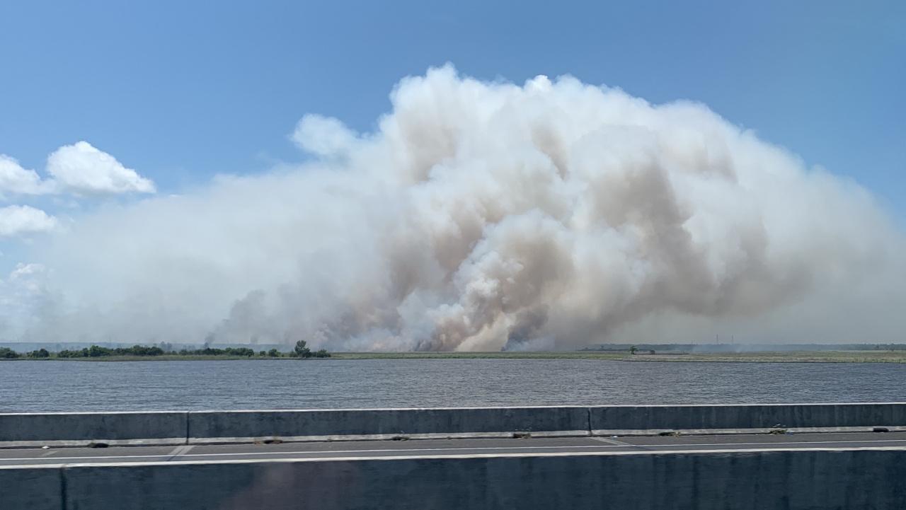 Fire in the grass behind Jim's-f56fee9c-4ea5-4e2f-8ab1-aea9c56b73e0-jpg