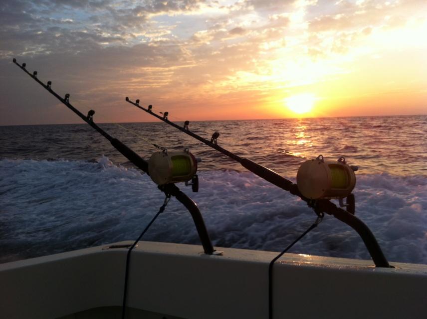 2 Wahoo near the Nipple Sunday-sunset-w-rods-gunwale-45-hatteras-jpg