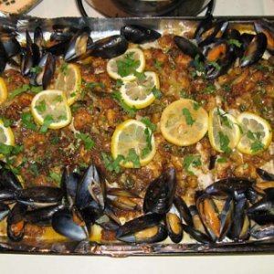 Catfish with shrimp and crab stuffing over the top and mussels sauteed in lots of garlic and butter.