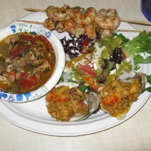 Seafood gumbo, oysters beinville, grilled shrimp and a kalamata and anchovy tapenade salad.